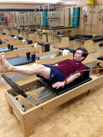 John Hays doing Pilates at Castle Hill Fitness