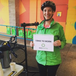 Our first bike commuter kicks off our morning with a smile. - Bike to Work Austin 2015
