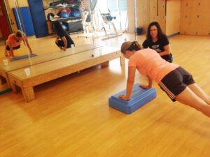 Amy working with personal trainer Tara Penawell