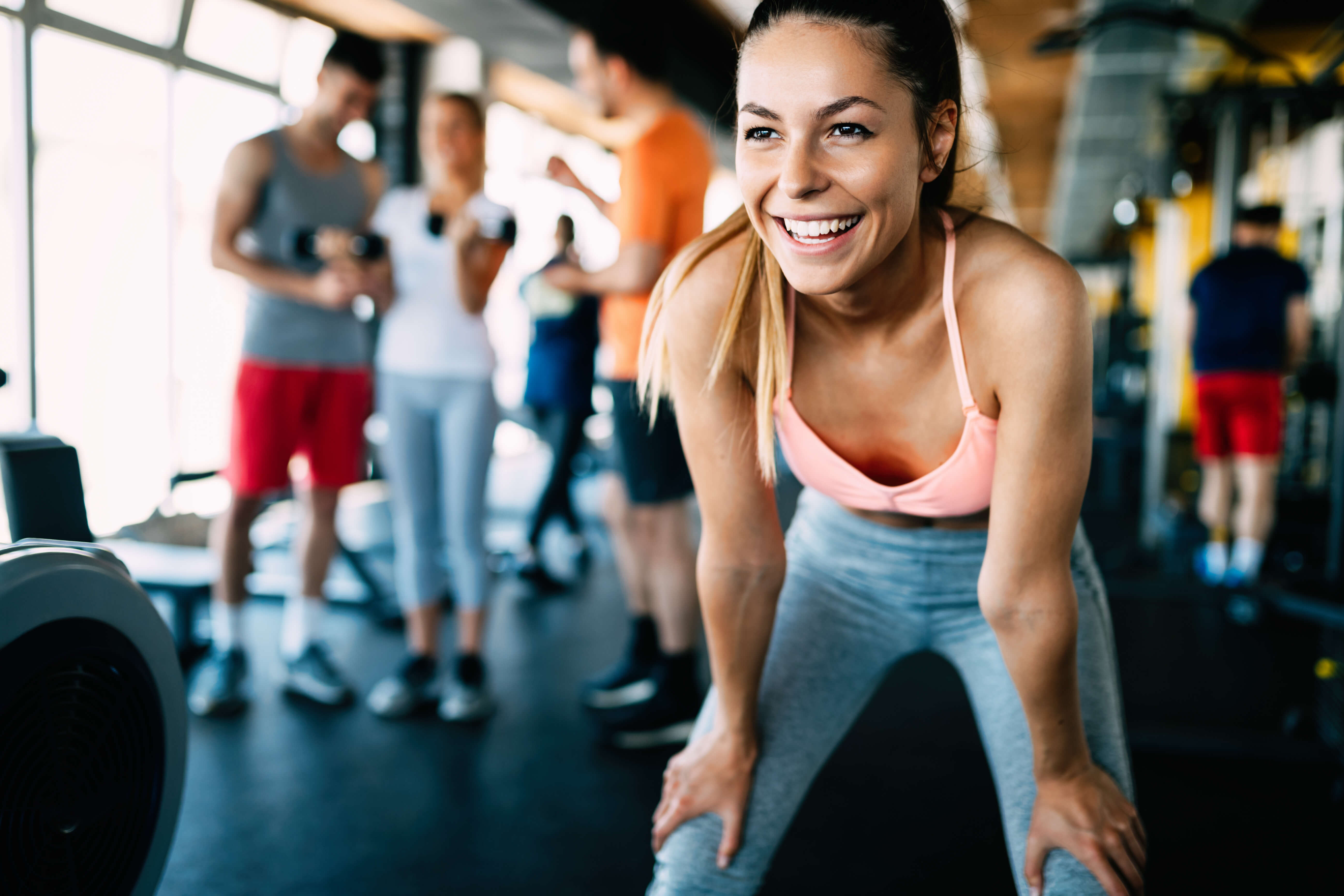 young woman smiling in a gym