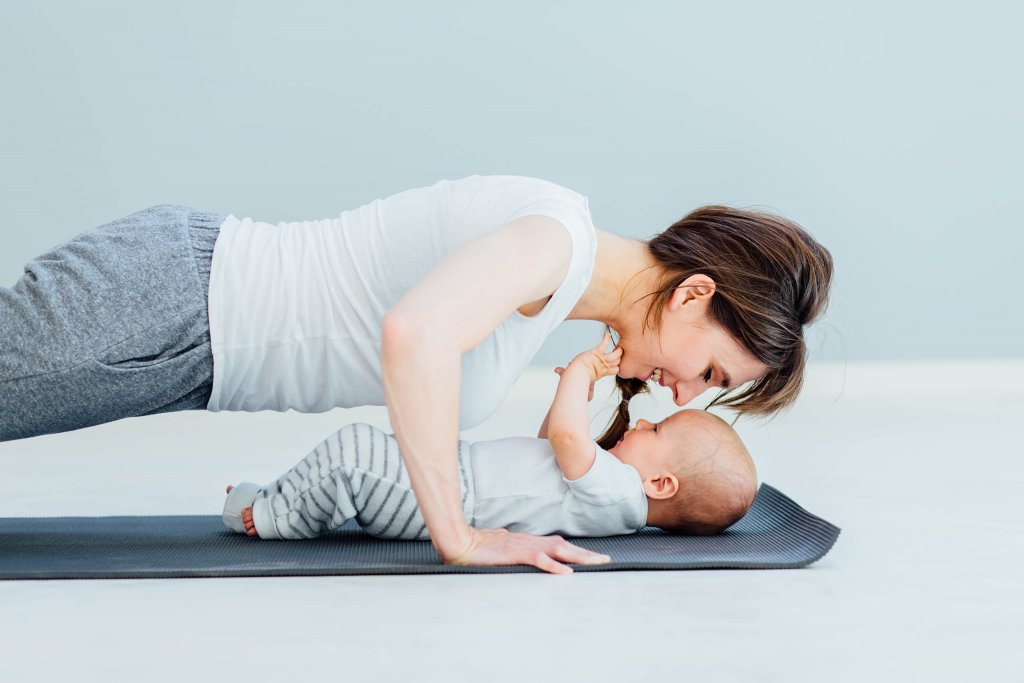 Mom doing yoga with her baby