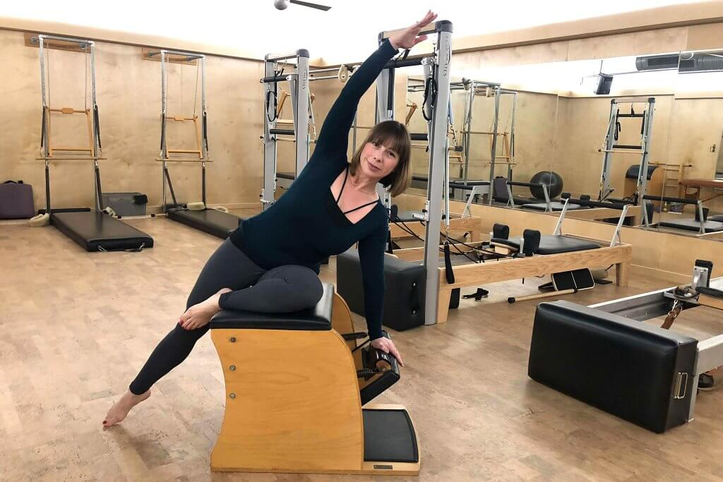 Celeste demonstrating the chair Pilates piece