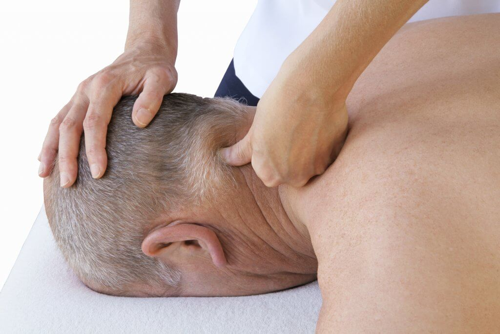man receiving neuromuscular therapy session