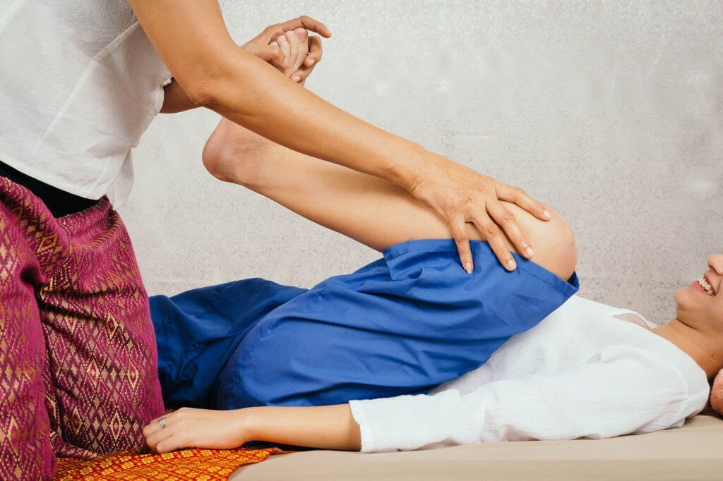 persona giving a thai massage