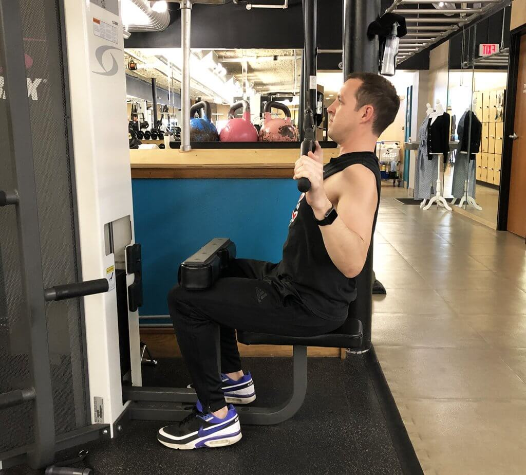 Fifth Step of Lat Pull Down Exercise with Keith Kohanek - Keep shoulders down and back, while slowly pulling bar down to the chest.