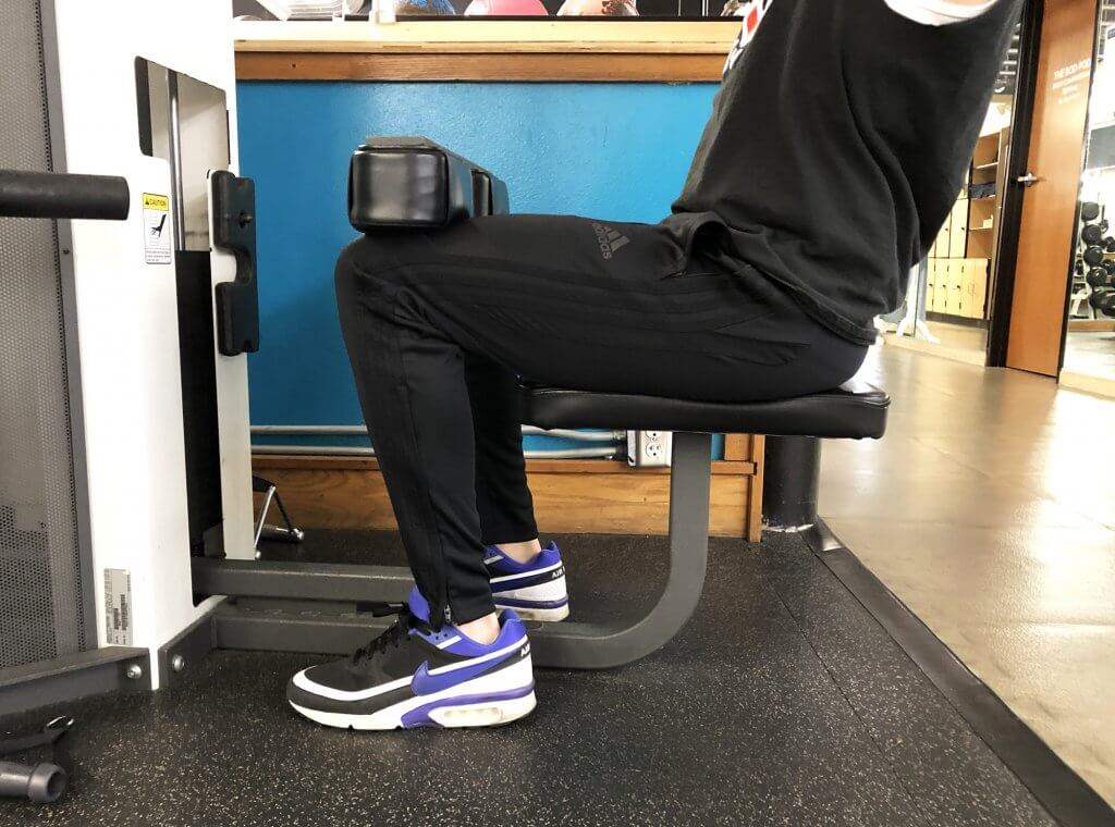 Lat Pull Down Exercise with Keith Kohanek - Thigh Guard Resting Properly Against Thighs