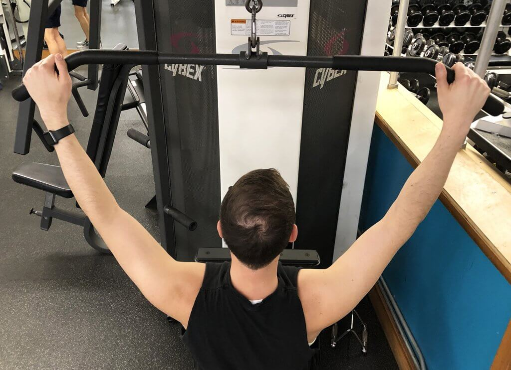 Second Step of Lat Pull Down Exercise with Keith Kohanek - Wide Grip on Bars, Slightly Wider Than Shoulders