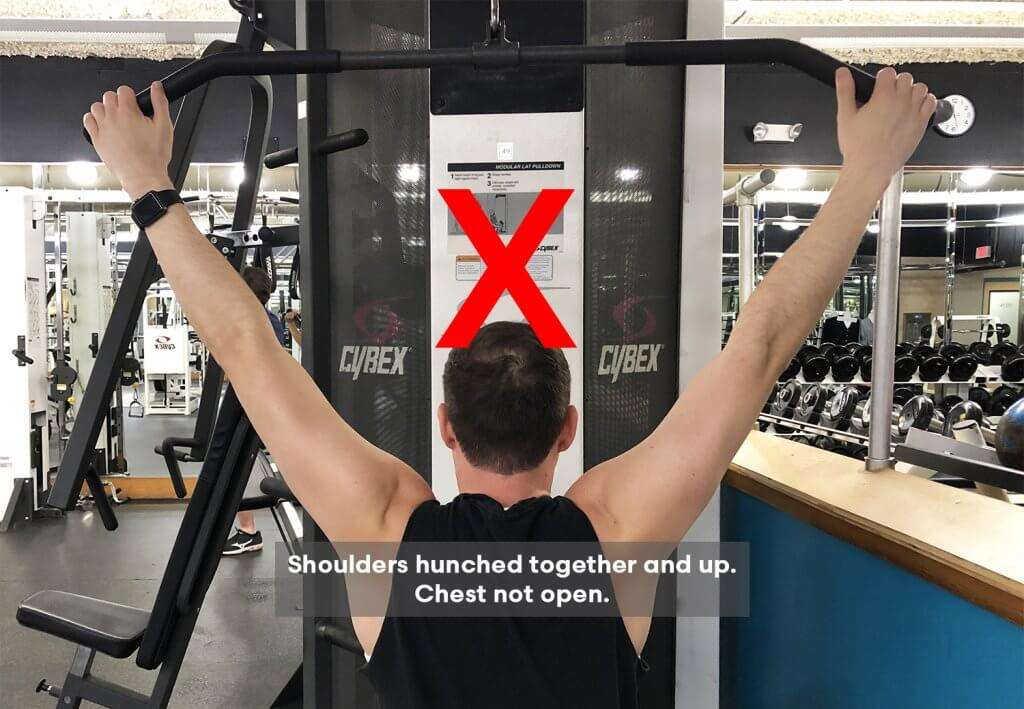 Bad Variation of Fourth Step of Lat Pull Down Exercise with Keith Kohanek - Shoulders are hunched together and pulled up to the ears.