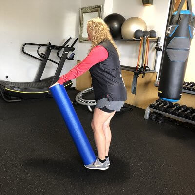 Personal Trainer Leslee Felman Demonstrating Starting Position of Single Legged Deadlifts