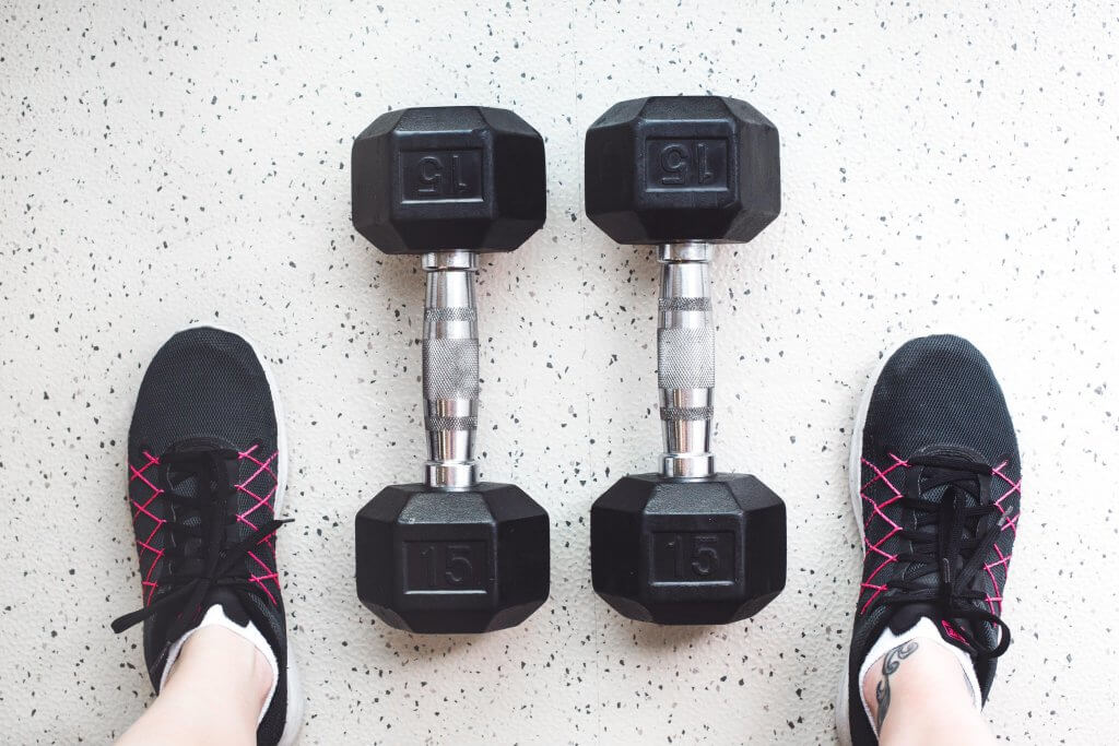 Dumbbells and gym shoes for at home gym equipment