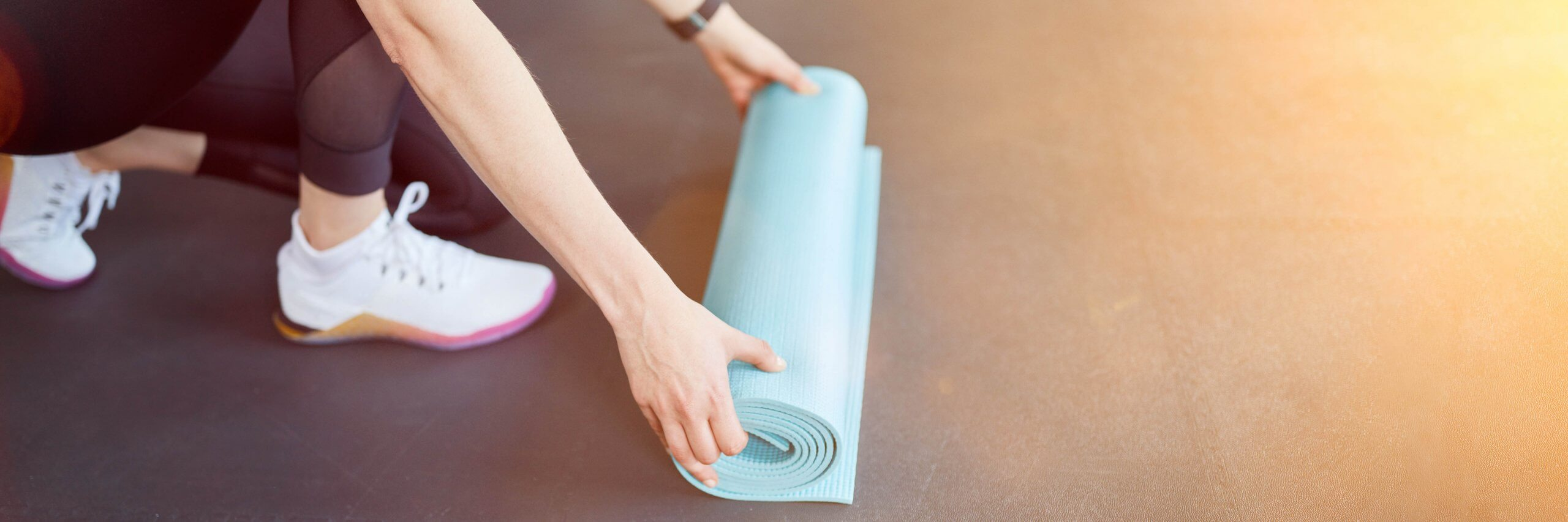 Girl Rolling Out a Yoga Mat
