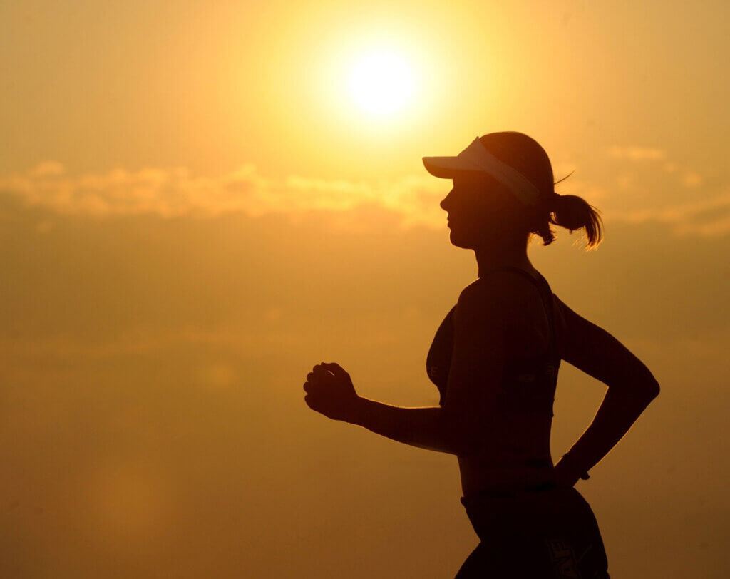Woman Exercising to Improve Immune System